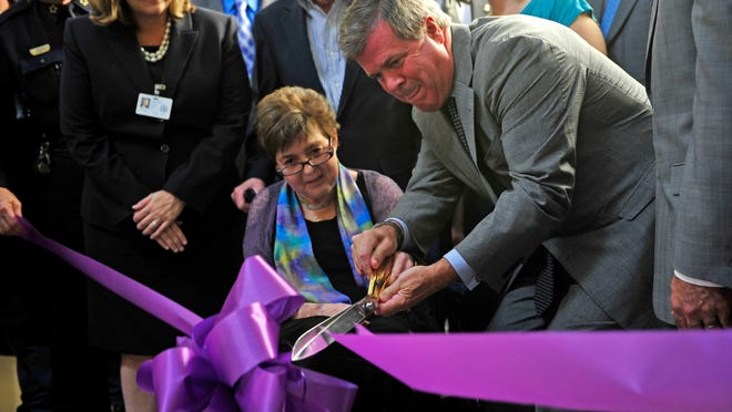 Mayor Karl Dean, right, and Jean Crowe officially open the Jean Crowe Advocacy Center. The center gives domestic violence victims a comfortable space away from the courtroom to speak with a victims advocate or an assistant district attorney before they go to court.