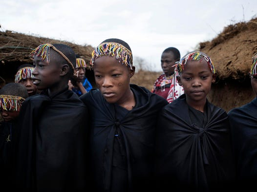 Only recently has the nomadic Maasai community of Esiteti in Kenya moved to stop the illegal practice of female genital mutilation and transition to an alternative rite of passage for their girls into womanhood around age 12. At the alternative ceremony, the dress is still the customary black robes and crowns of beads used when a girl was circumcised.