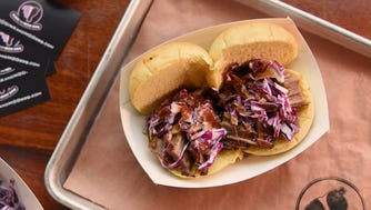 Food Truck Mash-Up 2018 preview event held at the Meadowlands racetrack on Thursday May 17, 2018. Sandwich from Oink and Moo BBQ.