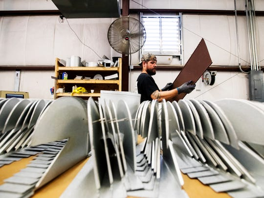"James Rupe an employee at Architectural Metal Flashings in Cape Coral manufactures an item on Tuesday. The business is being recognized along with others at Catch the Vision, an event billed as a ""real estate look forward."""