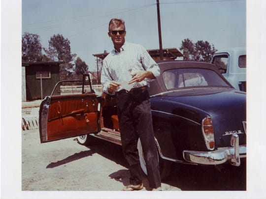 Tab Hunter with his 1957 Mercedes 220S convertible, which he bought in December 1956 against his manager's advice. Hunter said the car had a black with red leather interior. He paid $6,000 for it.