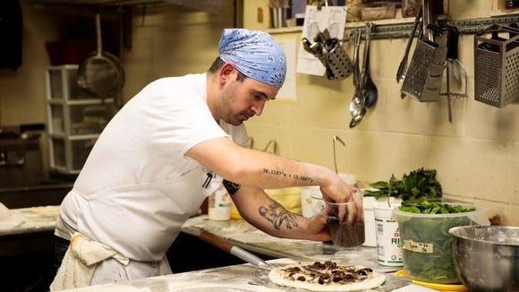 Chef Manny Augello prepares a Neapolitan classic pizza