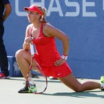 Sabine Lisicki of Germany stretches between points in the third set of her match against Simona Halep of Romania during the 2015 U.S. Open at USTA Billie Jean King National Tennis Center.