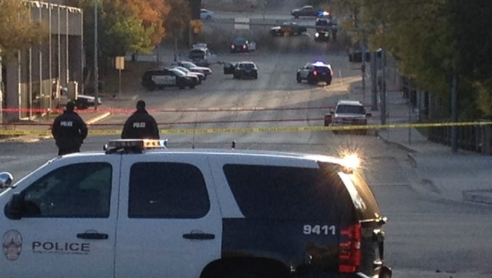 Police tape marks off the scene after authorities shot