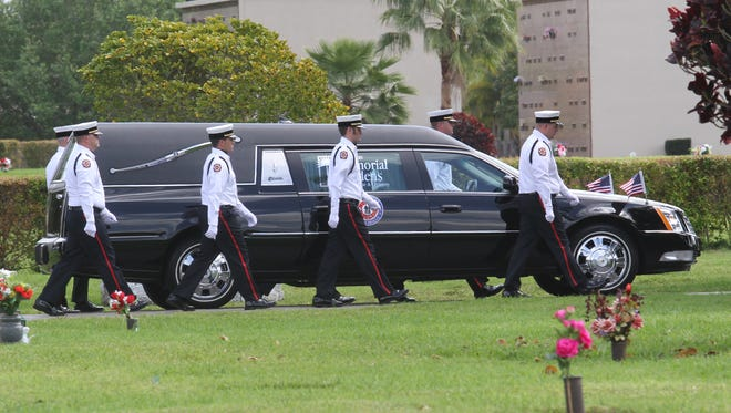 Pallbearers follow the casket of South Trail Firefighter Danielle DiBenedetto during procession at Fort Myers Memorial Gardens on Wednesday.