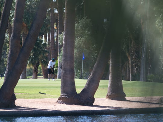 Jay Manning putts on the 2nd green on May 5, 2017, at Encanto Golf Course in Phoenix. In 2013, the City Council voted to borrow more than $15 million from parks initiative funds to pay off debt from its struggling golf courses.