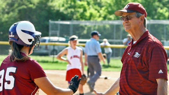 Ezell-Harding coach Don Freudenthal, right, notched his 800th career win Tuesday.