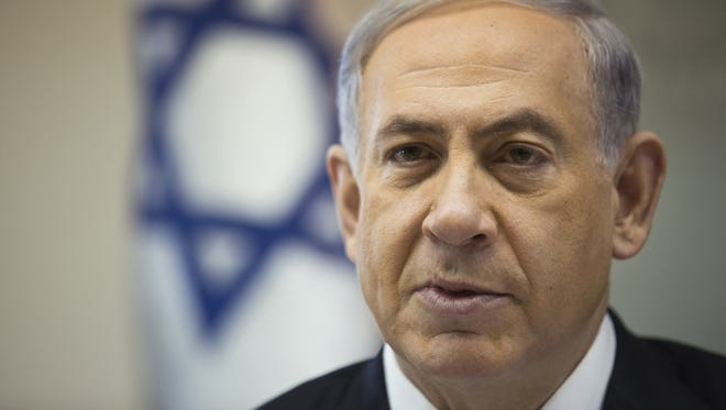 Israeli Prime Minister Benjamin Netanyahu attends the weekly Cabinet meeting in Jerusalem on Dec. 21, 2014.