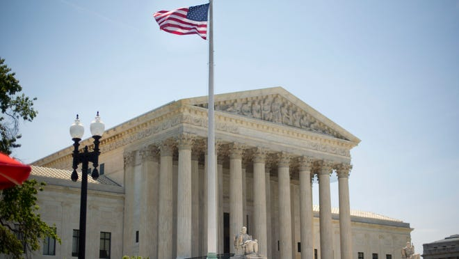 The Supreme Court building in Washington, Monday, June 30, 2014, following various court decisions. The court ruled on birth control, union fees and other cases. (AP Photo/Pablo Martinez Monsivais) ORG XMIT: DCPM110