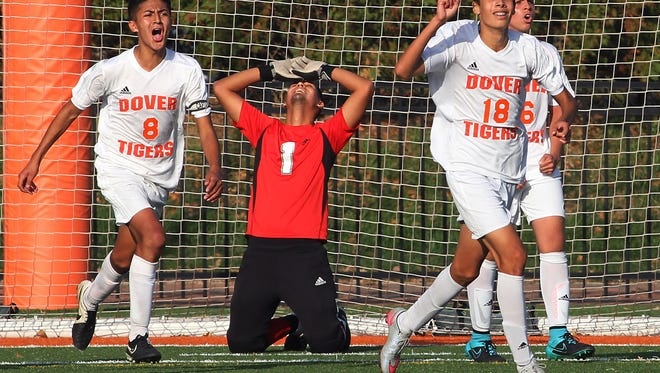 Dover's Bryan Calle, l, Isaiah Flores and Camilo Pareja celebrate as time runs out on Parsippany Hills during their NJSIAA North 2 Group II second-round matchup. The Tigers came from behind twice to beat Par Hills 3-2. November 6, 2015, Dover, NJ.