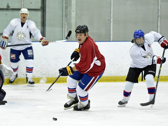 Former NHLer and Rochester American Rob Ray carries
