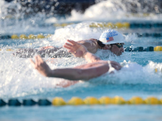 Michael Phelps during the men's 100m butterfly race at the 2014 USA Swimming Grand Prix Series.