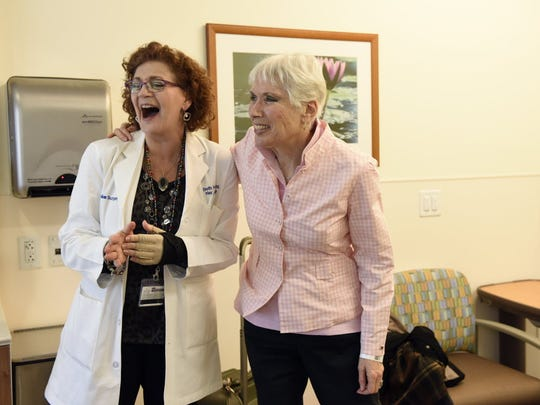 Registered Nurse Beth Perry jokes with patient Sandy