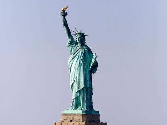 This Jan. 21, 2018, file photo, shows the Statue of Liberty in New York. A judge has ordered the U.S. Postal Service to pay $3.5 million to the sculptor of a Statue of Liberty replica at the New-York-New York casino-resort in Las Vegas after an image of the replica was mistakenly used on a stamp.
