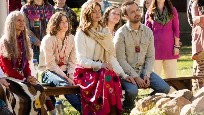 Sarah (Michelle Monaghan) and Eddie Lane (Aaron Paul) wrestle with their beliefs and each other in Hulu's 'The Path.'  and Aaron Paul as Sarah