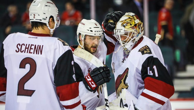 Feb 13, 2017: Arizona Coyotes goalie Mike Smith (41) celebrate win with teammates after the game between the Calgary Flames and the Arizona Coyotes at Scotiabank Saddledome. Arizona Coyotes won 5-0.