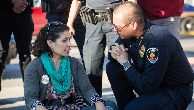 Sarah Silva,left, then the executive director of NM CAFe speaks with Las Cruces Police Chief Jaime Montoya, at the intersection of Picacho and North Main Street, about how the group would end the protest and march that started after ICE raids were held eariler in the day. NM CAFe held a press conference which than turned into a march that blocked traffic on multiple intersection in downtown Las Cruces. Wednesday, February 15, 2017.