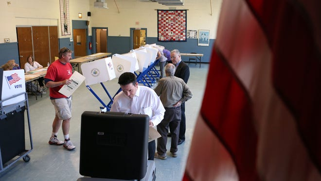 Voters cast their ballot at Street Community Center in New City on primary day, April 19, 2016.