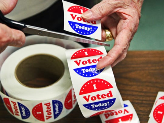 "Shelby County Election Commissioner Dee Nollner cuts, ""I Voted Today,"" stickers ."
