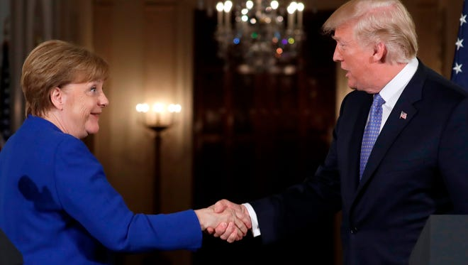 Trump Tussles With German Chancellor Merkel Over Iran And Trade