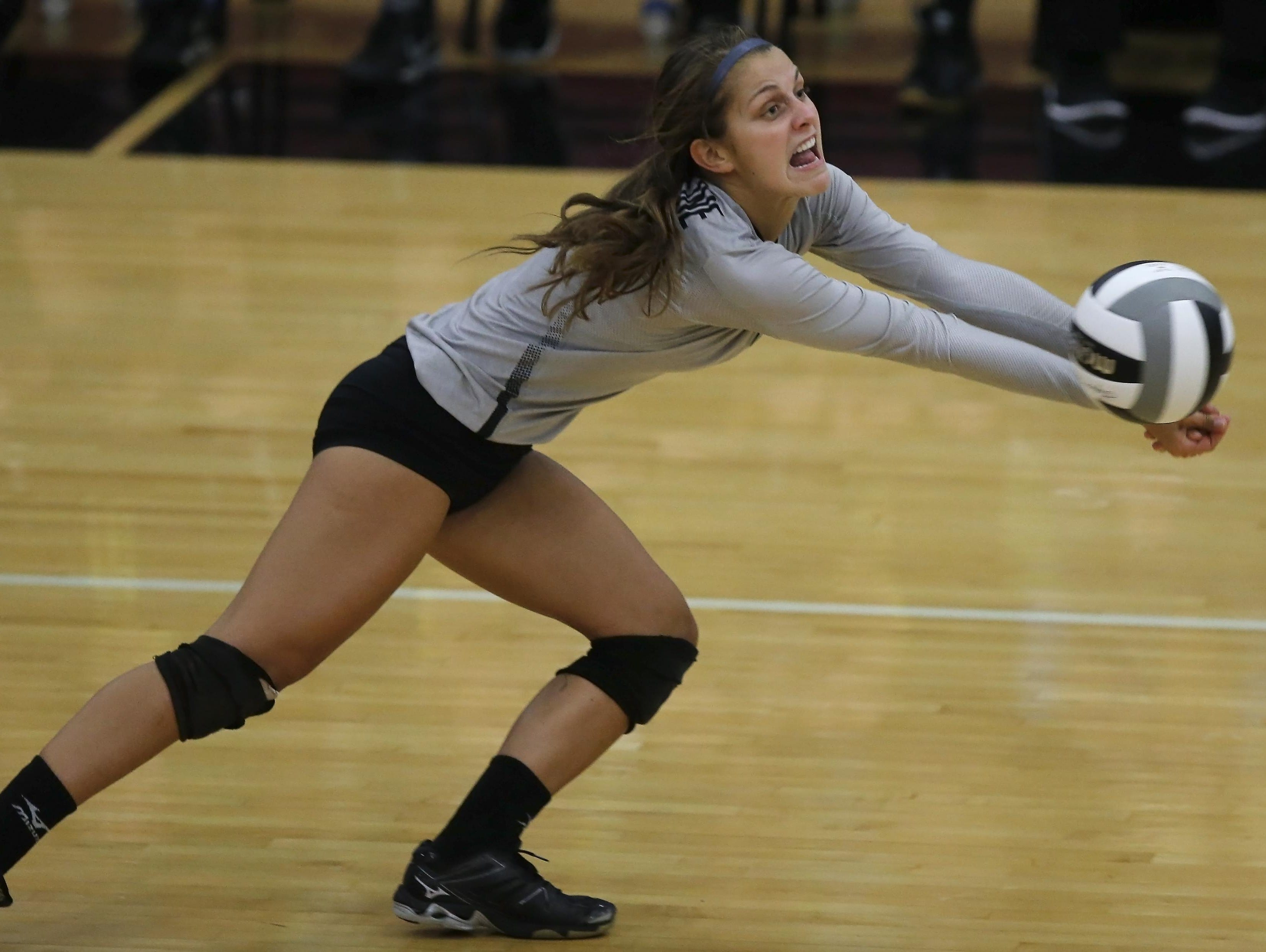 Ursuline's Avery Naylor dives for a dig during the Lions' win over Lakota East Tuesday.