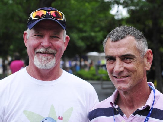 Mark Craig and partner Jim Ashabranner pose for a picture during the annual Nashville Pride Festival on Saturday morning.