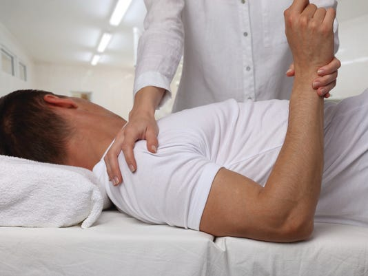Chiropractic, osteopathy, manual therapy. Therapist doing healing treatment on man's back. Alternative medicine, pain relief concept. Physiotherapy, sport injury rehabilitation