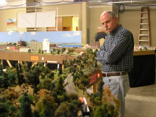 """Jack Mason got a part-time job at model railroad supplier EngineHouse Services in Green Bay after retiring. """"It pays for my toys,"""" he said."""