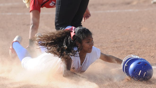 Cooper's Keiana Kemp steals third base in the fifth inning while Lubbock Cooper third baseman Marli Goolsby fields the throw. Kemp, who had her first of two RBI doubles in the inning, scored on Camille Scott's ground out to the pitcher in the inning. Lubbock Cooper beat the Lady Cougars 9-4 in the District 4-5A game Monday, April 10, 2017 at Cougar Diamond.
