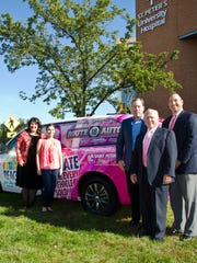 Route 18 Auto in East Brunswick is donating $50 for every car sold during October's Breast Cancer Awareness Month to the Breast Center at Saint Peter's University Hospital in New Brunswick. Shown in front of the hospital with a Route 18 vehicle promoting the drive are, from left,  Emily Lyssikatos, associate executive director, Saint Peter's Foundation; Mariel Hunt, marketing associate, Route 18 Auto; Bill McDonagh, owner/dealer principal, Route 18 Auto; Bob McCusker, community relations officer, Route 18 Auto, and Michael Loch, director of annual giving, Saint Peter's Foundation. Every dollar raised will support breast cancer prevention and treatment programs. Additional donations will be accepted at http://www.rt18cjdr.com/reach-for-the-cure.htm.