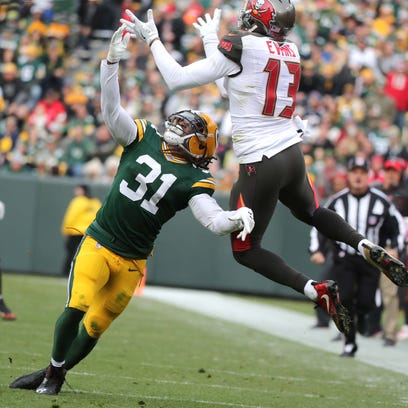 Green Bay Packers cornerback Davon House (31) gets