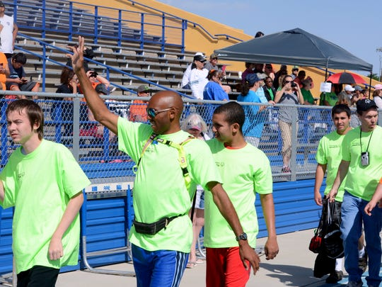 Team Carlsbad, wearing lime colored shirts, makes its