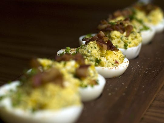 Bacon jalapeno deviled eggs are an easy make-ahead snack for Superbowl. Garnish the eggs with crispy bacon just before serving.
