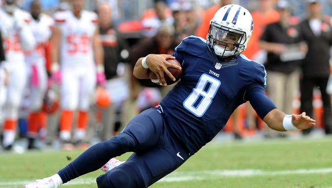 Titans quarterback Marcus Mariota gains big yards in the third quarter Sunday to set up running back DeMarco Murray's touchdown.