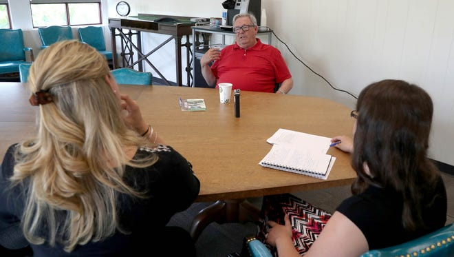 William Charron, 71 of Bloomfield Hills talks with (L to R) Bree Boettner and Hannah Sabal with the Detroit Historical Museum inside a conference room at the museum in Detroit on Saturday, June 18, 2016. Sabal and Boettner are two of several people collecting audio stories of people that have stories to tell about being in Detroit in 1967 and the riots that happened that summer.