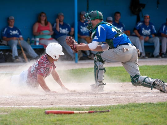 Joe Ramos (55) of the Scorpions slides into home plate in the second inning as the Scorpions face off against Behnke in the City Musial Tourney held at Nichols Field in Bailey Park.