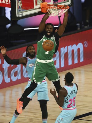 Boston Celtics guard Jaylen Brown (7) dunks in front of Miami Heat forward Jae Crowder (99) during the second half of a game on Tuesday, Aug. 4, 2020, in Lake Buena Vista, Fla.