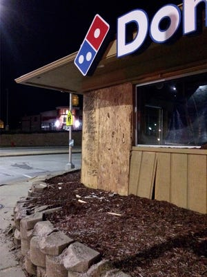 Plywood covers the corner of the Dominos building at 14th Street and Erie Avenue following a truck crashing into the building Wednesday March 8, 2017 in Sheboygan.