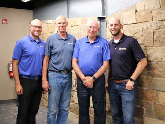 The second generation of the Walker family of Walker Manufacturing, Bob and Dean Walker stand with the third generation who will one day take their place. From left: Ryan Walker, Dean Walker, Bob Walker, and Ted Walker.