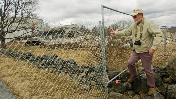 22. Ethan Bishop, of Gettysburg, a former National Park Service employee who worked inside the Cyclorama building for six years in the 1970s, watched as demolition crews dismantle the building in March 2013.