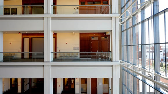 Doors leading to a newly-built fifth-floor courtroom can be seen at center, during a tour of the recently finished fifth floor of the York County Judicial Center on Wednesday, June 24, 2015. When the seven-story judicial center was finished in 2004, the fifth floor was purposely left vacant to allow for additional courtrooms and chambers to be built at a later time. President Judge Stephen P. Linebaugh said it was anticipated that those facilities would be needed to accommodate increased caseloads by 2015. The completed fifth floor, which was estimated to be a $7.1 million project but came out about $6.9 million, has eight smaller, non-jury courtrooms, multi-purpose rooms and two judges' chambers. Chris Dunn -- Daily Record/Sunday News