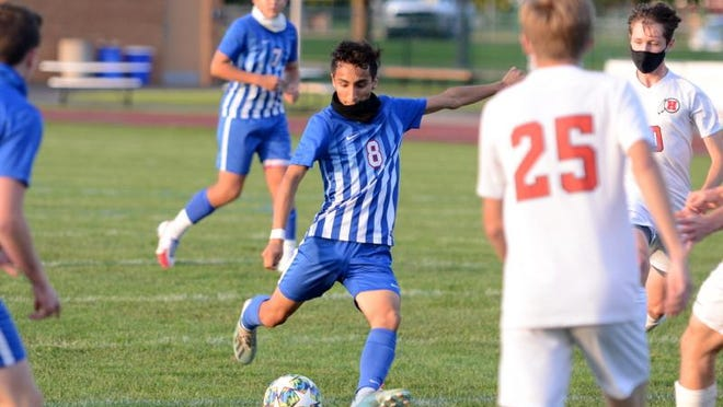 Lenawee Christian's Francisco Cabrera fires away during a game Thursday against New Boston Huron.