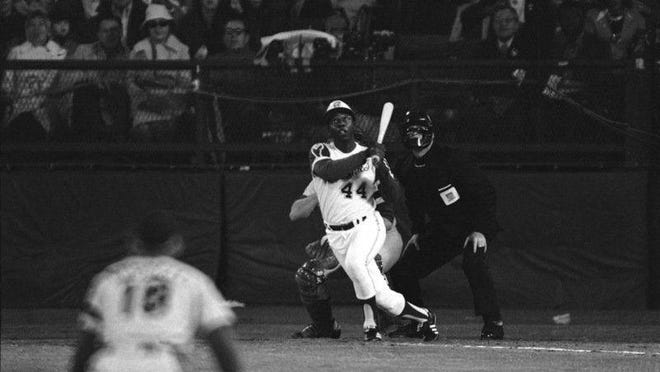 Hank Aaron watches his home run that broke Babe Ruth's all-time record in 1974.