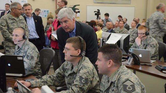 Gov. Rick Snyder watches a training exercise Tuesday for the cyber range at the 110th Airlift Wing at Battle Creek Air National Guard Base.
