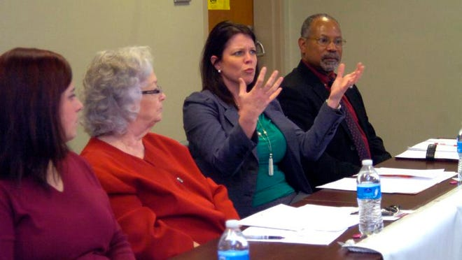 Panelists at an American Association of University Women forum on pay equality listen Wednesday as Liz Lowry (second from right) comments. The other panelists are (from left) Paige Smith, Linda Burns and Gerber Porter.