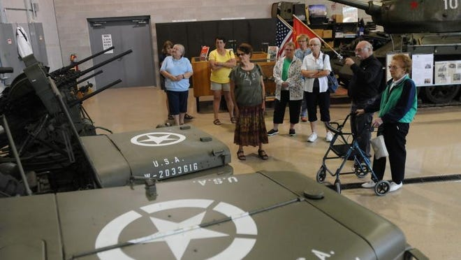 Bob Griffin, a volunteer with the Military Veterans Museum, gives a tour to wives of veterans in this 2014 file photo.