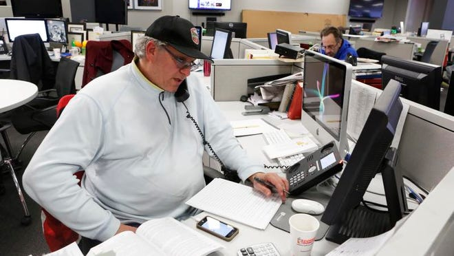 CPA Jason Roif helps a caller during a tax hotline session at The Journal News office, March 1, 2014 in White Plains.