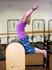 Leah Sine, owner of Pilates Edge USA, executes a pilates