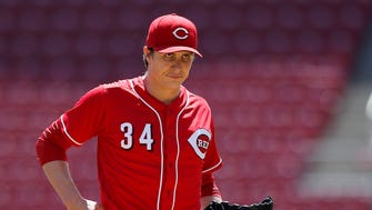 Cincinnati Reds starting pitcher Homer Bailey (34) recollects himself after giving up a solo home run in the top of the second inning of the MLB National League game between the Cincinnati Reds and the Atlanta Braves at Great American Ball Park in downtown Cincinnati on Thursday, April 26, 2018.
