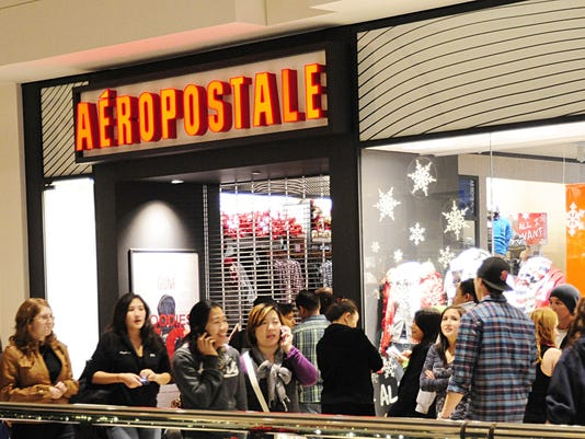 Shoppers wait to enter the Aeropostale s